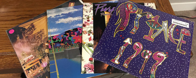 fanned stack of Prince albums on vinyl, with 1999 on top