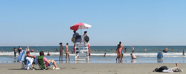 lifeguards and beachgoers on a sunny day