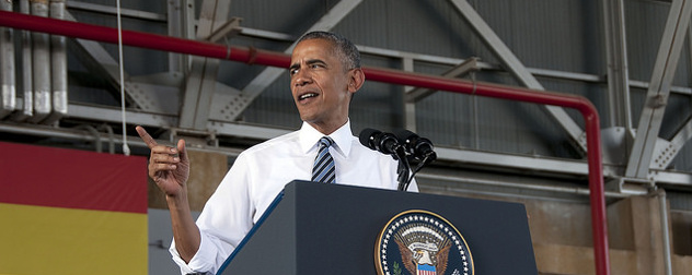 Barack Obama, speaking at a podium adorned with the presidential seal