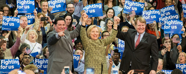 Hillary Clinton, center, holding hands with Pittsburgh Mayor Bill Peduto and Allegheny County Executive Rich Fitzgerald in the midst of supporters at a rally