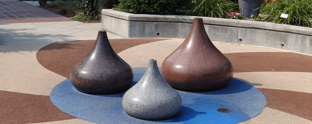 sculptures shaped liked Hershey's Kisses in light brown, dark brown and silver