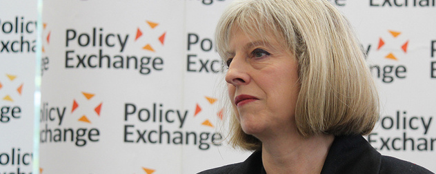 Theresa May in front of a Policy Exchange background