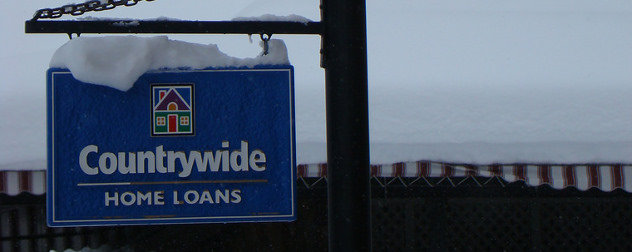 weathered outdoor sign for Countrywide Home Loans, with snow