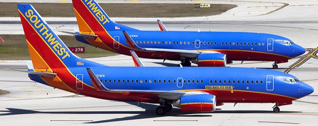 two Southwest Airlines planes on the runway at Fort Lauderdale Hollywood Airport