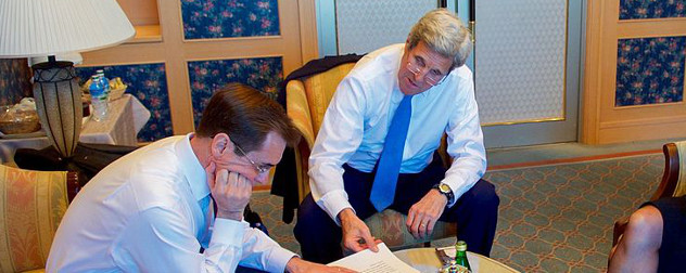 John Kirby and John Kerry, seated in shirtsleeves