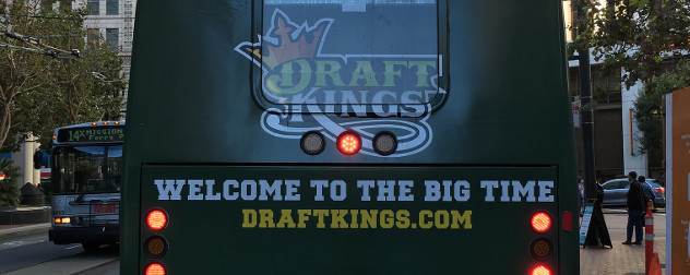 bus ad for DraftKings with the tagline 'Welcome to the Big Time'