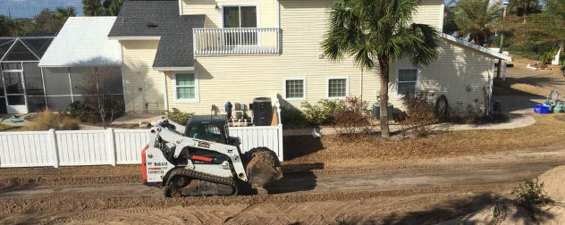 Plow clearing sand from a residential street