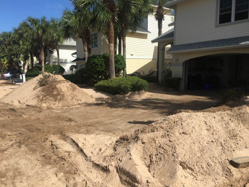 beach property's driveway with sand removed
