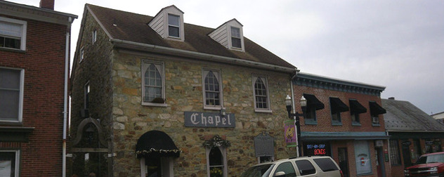 brick facade of two-story building with the word 'Chapel' on the front