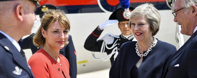 PM Theresa May greeted on her arrival to Italy
