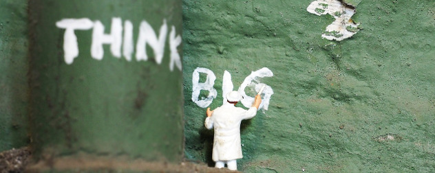 miniature figurine of a painter below the words 'Think Big'