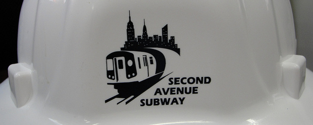 detail of a hard hat with a Second Avenue Subway logo