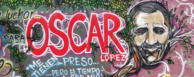 graffiti depicting Oscar Lopez Rivera, with the text 'luchar para Oscar Lopez' and 'Me tienen preso ... pero el tiempo'