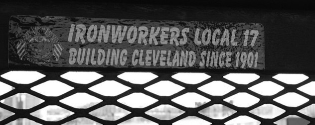 black and white image of a decal on a bridge that reads 'Ironworkers Local 17, Building Cleveland Since 1901'