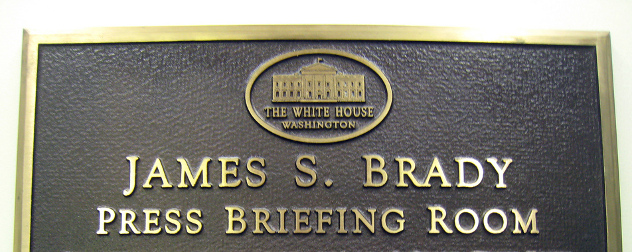 plaque identifying the James S. Brady Press Briefing Room with a White House logo