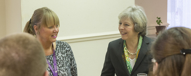 Theresa May visitng a mental health centre in Surrey