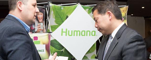 Human logo on a display, with then-Deputy Secretary of Labor Chris Lu