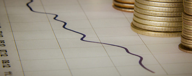 a line graph with stacks of coins on the edge