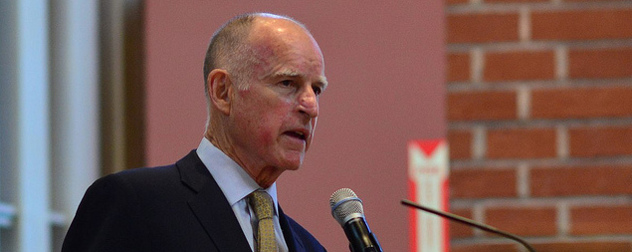 Jerry Brown speaking at a microphone