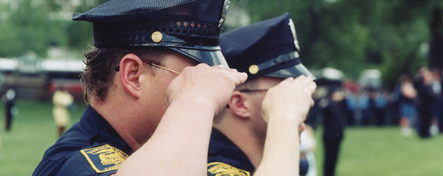saluting police officers with Hartford, CT insignia on their arms