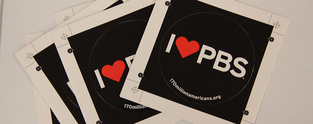 black sticker with white text reading I (heart) PBS