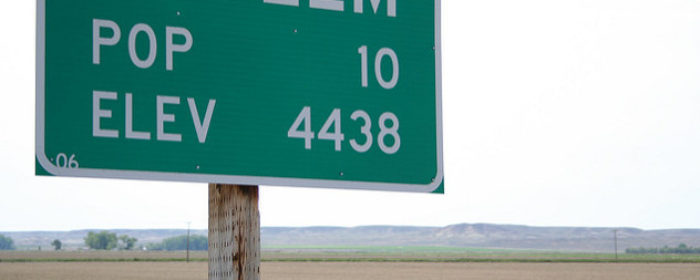 detail of highway sign reading POP 10 ELEV 4438
