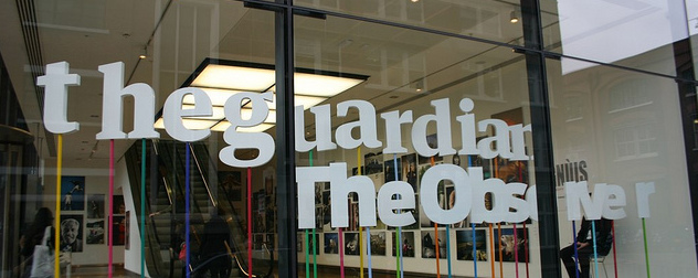 window sign for The Guardian and The Observer in the organization's London office