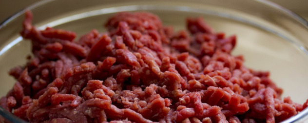 detail of raw ground beef in a glass bowl