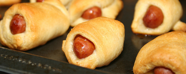 close-up of pigs in a blanket on a baking sheet
