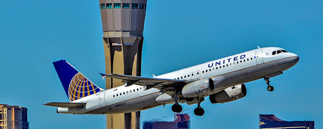 United airplane taking off in front of an air control tower in Las Vegas
