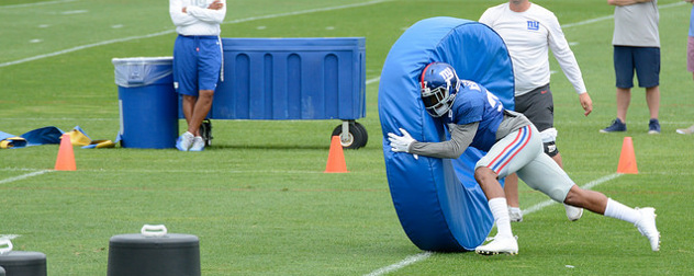 New York Giants player performing a drill at training camp