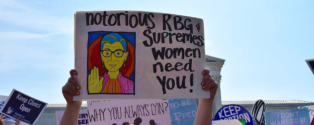 protest sign with illustration of Ruth Bader Ginsburg and text 'notorious RBG & Supremes women need you!'