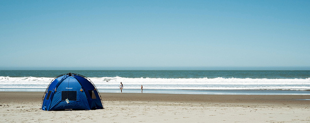 small tent with sides on a beach