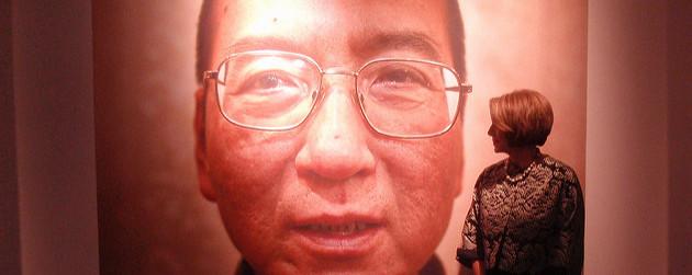 detail of a portrait of Liu Xiaobo, Nancy Pelosi looking on