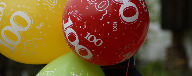 close view of colorful balloons with '100' printed on them