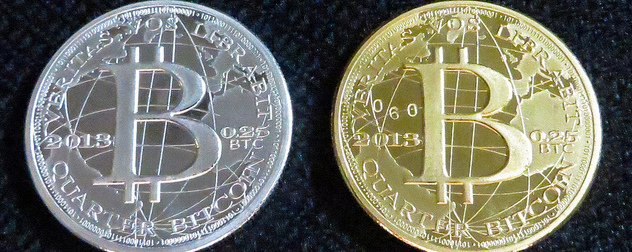 silver and gold colored coins with the bitcoin logo