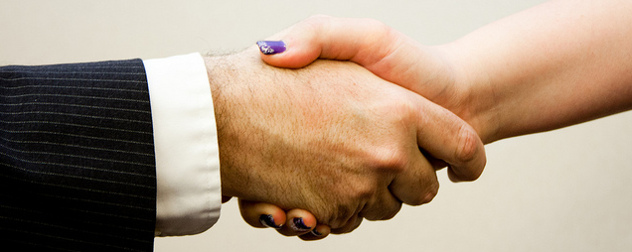 handshake with a person in a suit and a person with painted nails