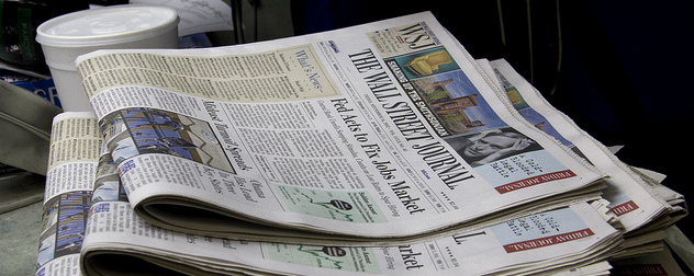 stack of copies of The Wall Street Journal