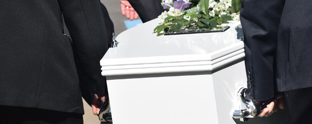 detail of pallbearers carrying a white coffin with flowers