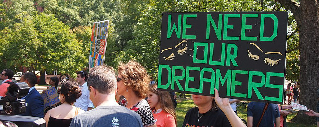 protester holding a sign that says We Need our DREAMERS