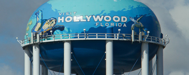 painted water tower with sea turtles and the message 'Visit Hollywood Florida'
