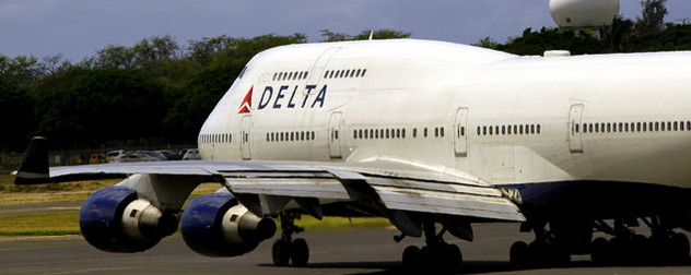 a Delta 747 taxiing on a runway