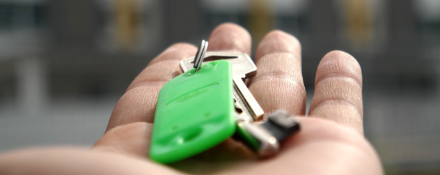 set of keys resting on an open, outstretched hand