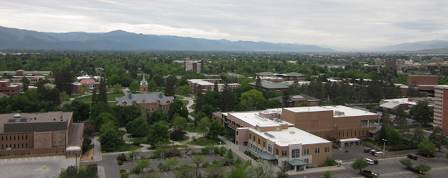 portion of the University of Montana Campus in Missoula as seen from the M-Trail with the Bitteroot Mountains in the back