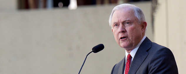 Jeff Sessions speaking at a microphone outdoors