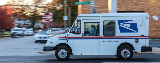USPS truck in motion