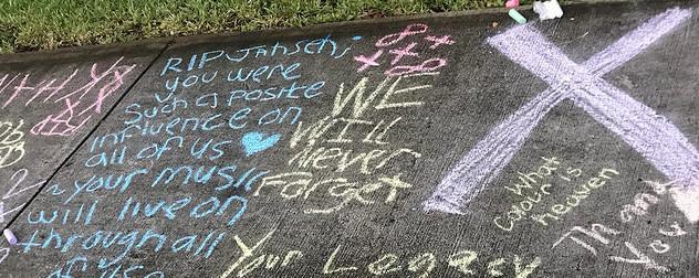 chalk messages on a sidewalk memorial to XXXTentacion