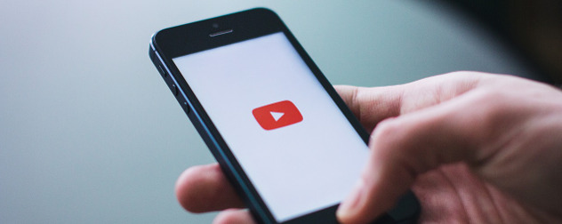 YouTube logo displayed on a smartphone screen with a white background