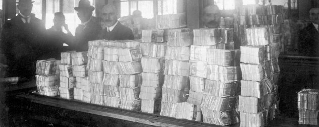 a large pile of cash on a countertop in the Reichsbank, Berlin
