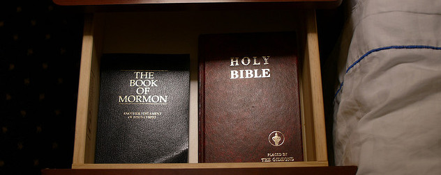 a Bible and a Book of Mormon in a nightstand drawer